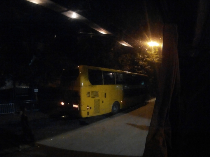 Yellow bus waiting for passengers to head to Ho Chi Minh.