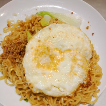 Walking into a random local store for a small plate of SGD1.50 delicious Indomie.